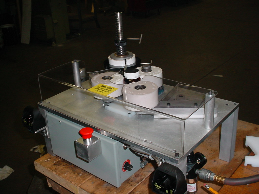 Bottle Taping Machine